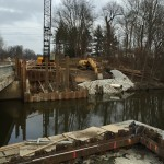 Pictured here is the south side of the bridge over Deep River.  The coffer dams are in place for the installation of the new footers.  The rock berm on the east bank is for temporary erosion control.